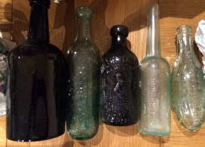 Attractive Maugham's Black-glass ginger beer bottle